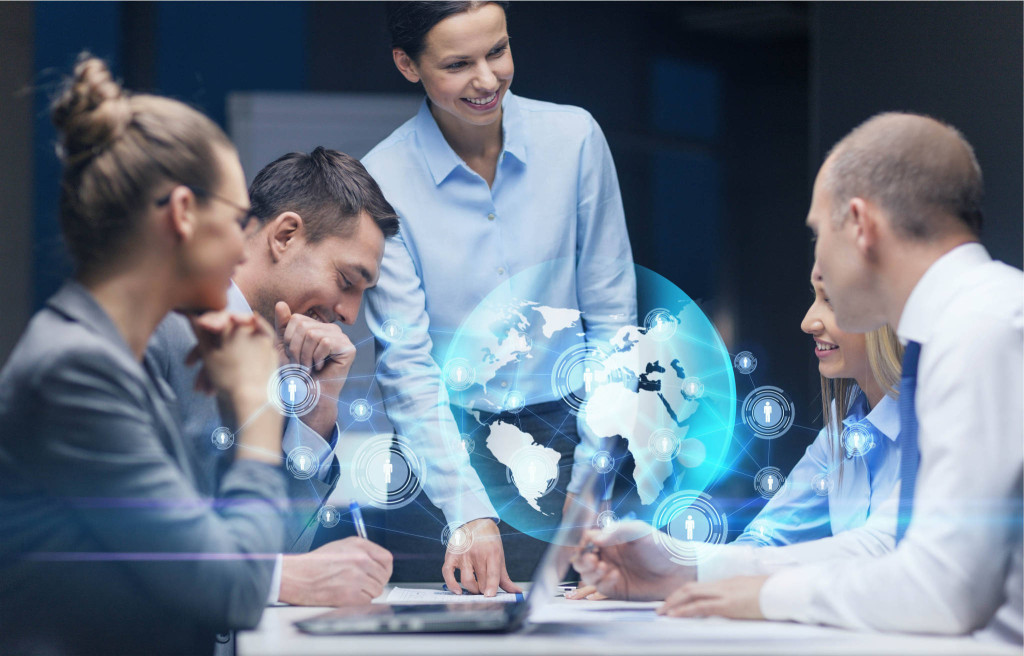 global business, technology, management , connection and people concept - smiling female boss talking to business team in office